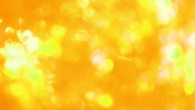 Złote tło bokeh lekkie tekstury, błyszczące światło słoneczne, miękkie rozmycie, wzór tapety