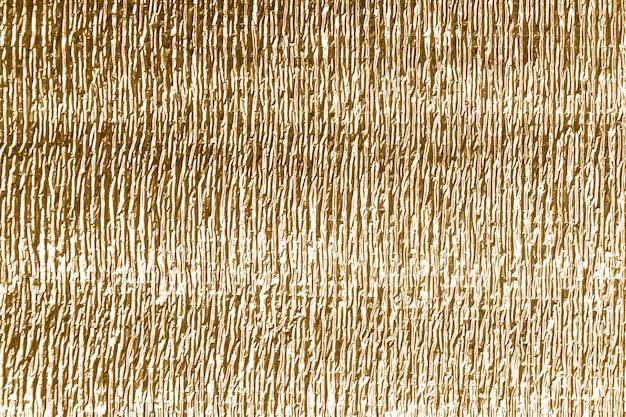 Złote tło z błyszczącą zmiętą powierzchnią dla tekstury tła