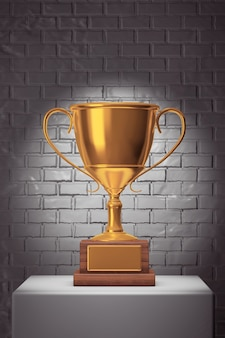 Złote trofeum nad białym stoiskiem przed ceglanym murem