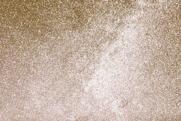 Złote ziarna brokatowe teksturowane tło | projekt o wysokiej rozdzielczości