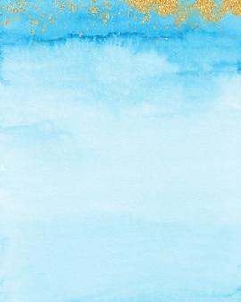 Złoto i pastelowe niebieskie tło akwarela, miękka niebieska tekstura