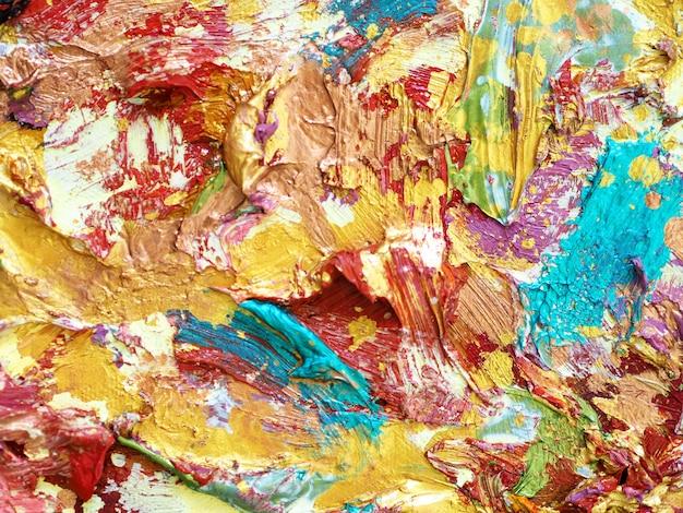 Złoto kolorowe farby olejnej tło i teksturowane.
