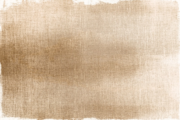 Złoto malowane na teksturowanym tle tkaniny