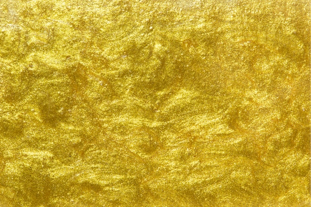 Złoto malujący textured ścienny tło
