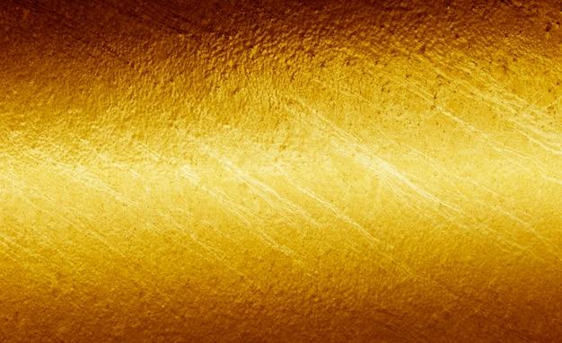 Złoto metalu tła błyszczący żółty liść złota tekstury tła