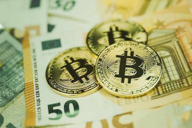 Złoty bitcoin euro tło. kryptowaluta bitcoinowa.