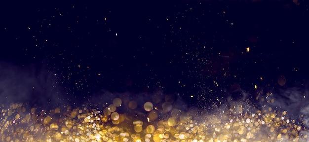 Złoty blask bokeh na ciemnym tle