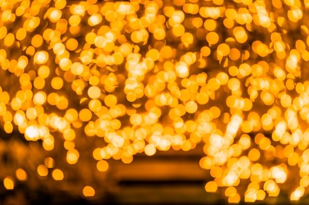 Złoty błyskotliwość rocznika świateł tło