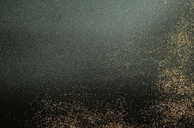 Złoty błyszczy na czarnym tle. świąteczny.