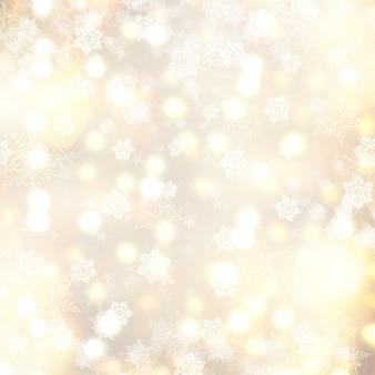 Złoty bożenarodzeniowy tło z płatkami śniegu i gwiazdami
