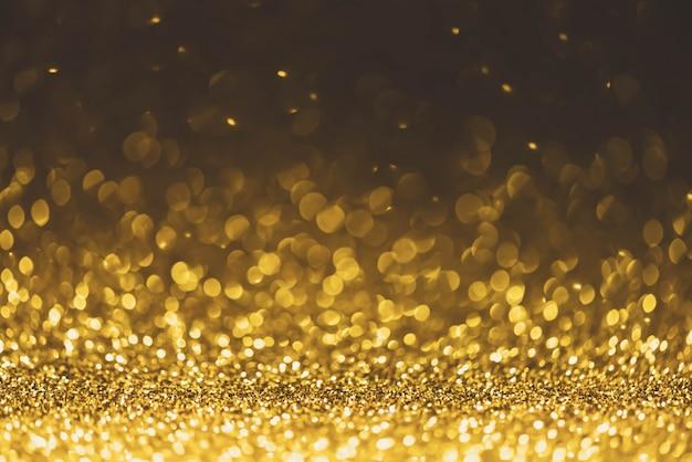 Złoty brokat blask światła tło. nieostry brokat abstrakcyjny migocząco lekki i błyszczący