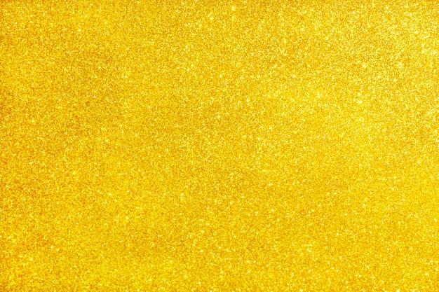 Złoty brokat tekstura musujące błyszczący papier pakowy tło