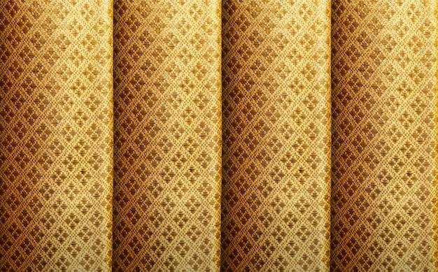 Złoty jedwab z rocznika królewskim deseniowym tłem