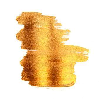 Złoty malujący szczotkarski tekstury tło. błyszcząca złota akrylowa plama na białym tle