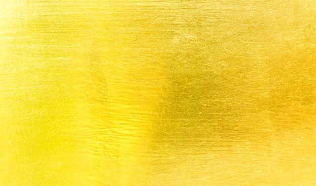 Złoty metal szczotkowany tło