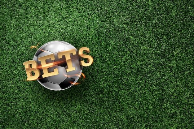 Złoty napis zakłady z piłki nożnej i tło zielony trawnik.