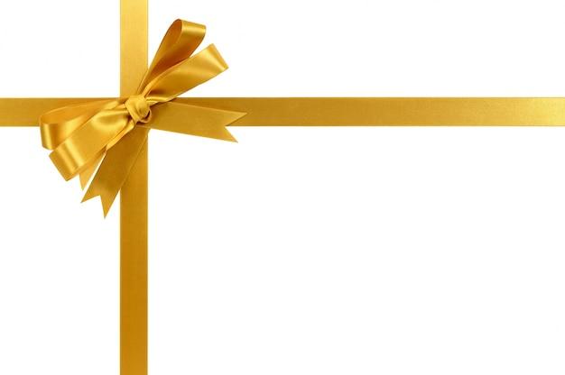 Złoty prezent wstążką i łuk