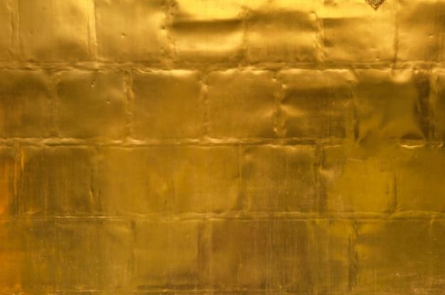 Złoty ścienny tekstury tło