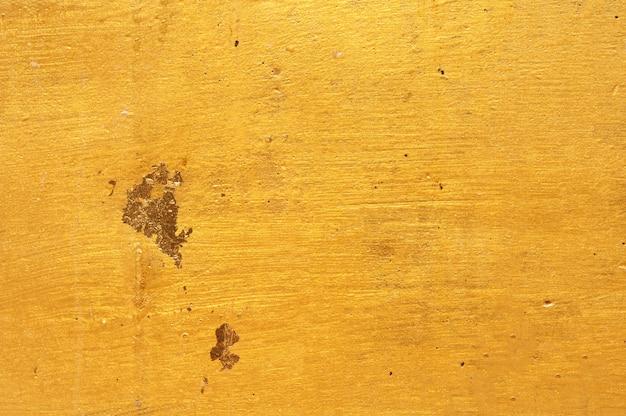 Złoty ścienny tło