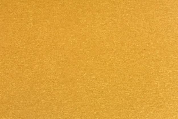 Złoty żółty luksusowy papier tekstury. wysokiej jakości tekstura w ekstremalnie wysokiej rozdzielczości