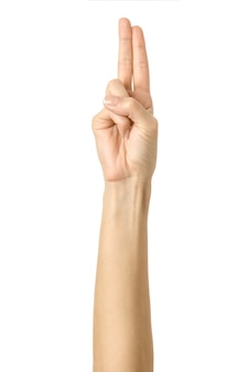 Złożone dwa palce. kobiety ręki gestykulować odizolowywam na bielu