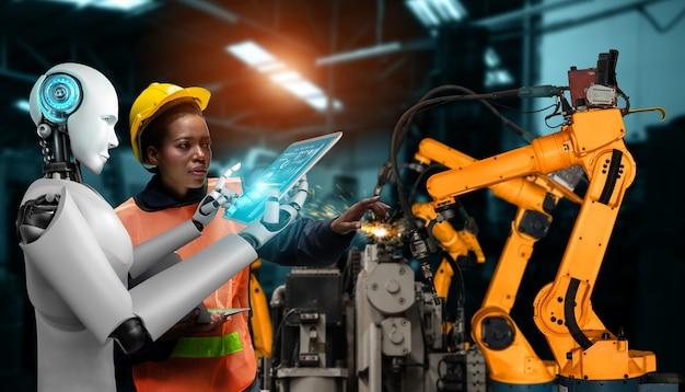 Zmechanizowany robot przemysłowy i pracownik ludzki współpracujący w przyszłej fabryce