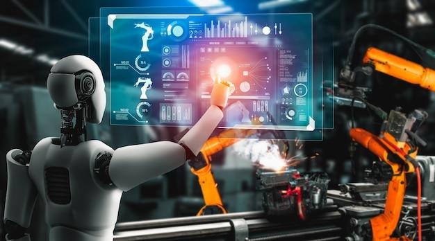 Zmechanizowany robot przemysłowy i ramiona robotów do montażu w produkcji fabrycznej.