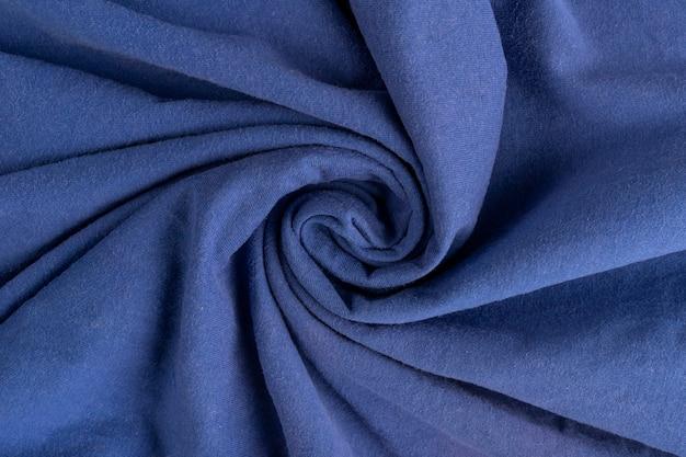 Zmięta lniana tkanina tekstura. pomarszczona tkanina. niebieski.