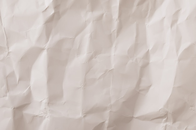 Zmięta papierowa tekstura, rocznika tło. neutralna beżowa tapeta