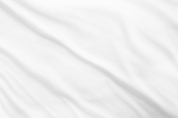 Zmięty biały bawełniany arkusz tkaniny tekstury poranne łóżko minimalistyczna pusta makieta tła