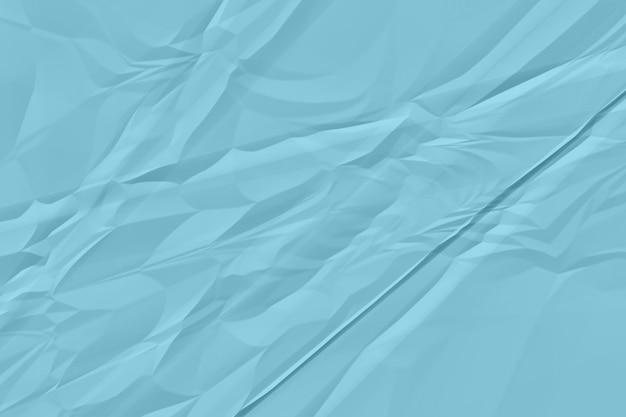 Zmięty błękitnego papieru tła zakończenie up