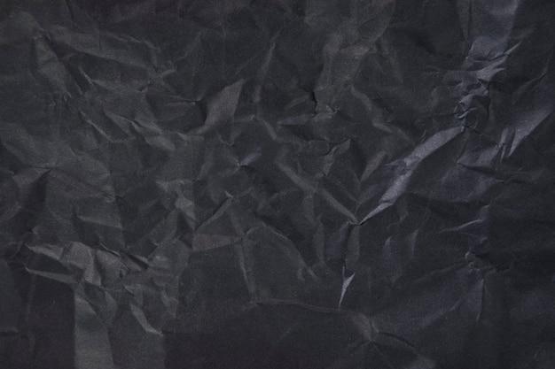 Zmięty Czarny Papier Jako Scena. Ciemny Ton Premium Zdjęcia