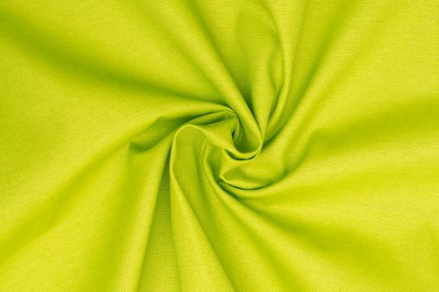 Zmięty neonowy zielony wapno textured tkaniny tło