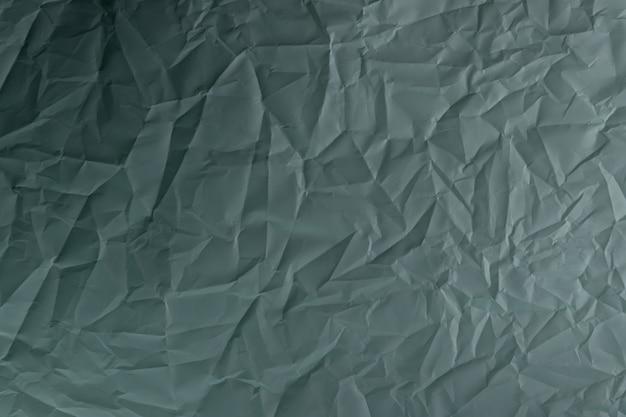 Zmięty papier. arkusz papieru kolory dark jungle green i outer space slate. szczegółowe tekstury w wysokiej rozdzielczości. abstrakcyjne tło dla tapety.
