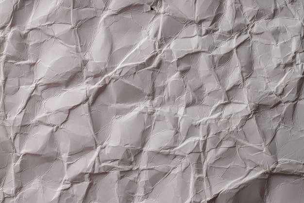 Zmięty papier. arkusz szaro-białego papieru. szczegółowe tekstury w wysokiej rozdzielczości. abstrakcyjne tło dla tapety.