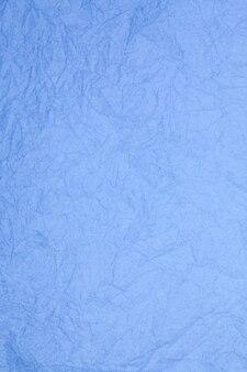 Zmięty papier niebieski vintage teksturowanej tło przestarzałe.