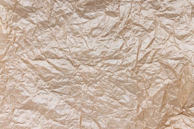 Zmięty papier pakowy brązowy tekstura tło