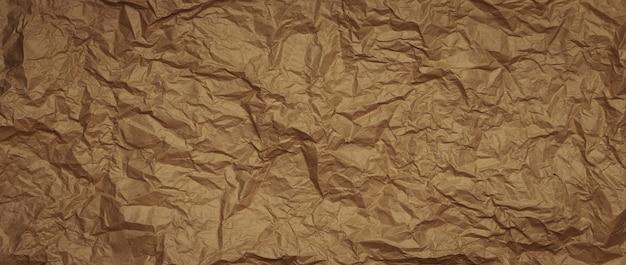 Zmięty papier pakowy tło. długi baner
