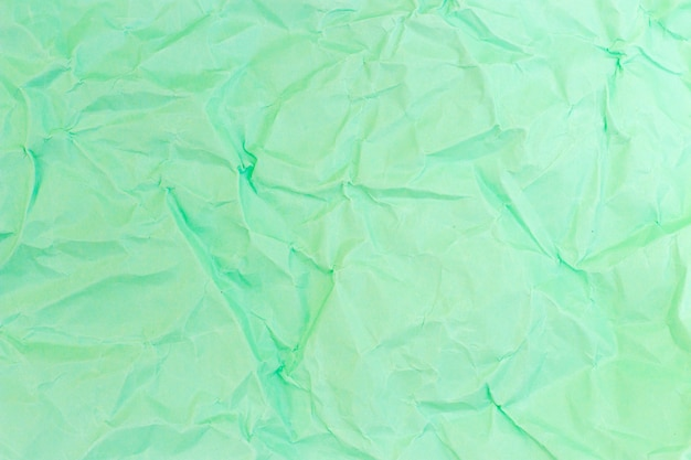 Zmięty papier turkusowy pastelowy kolor, tekstura, tło