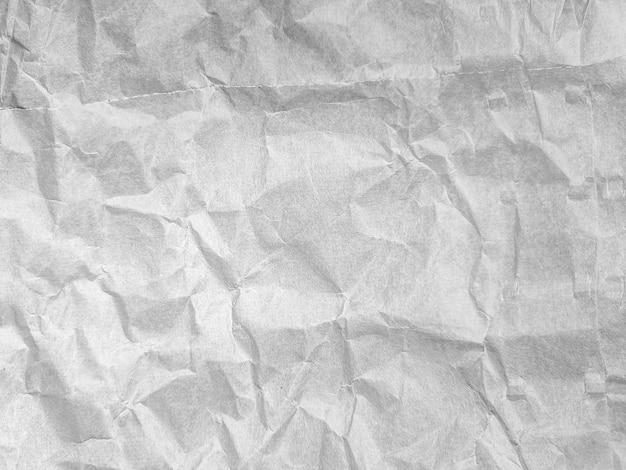 Zmięty pomarszczony papier do tła z bliska. widok z góry.