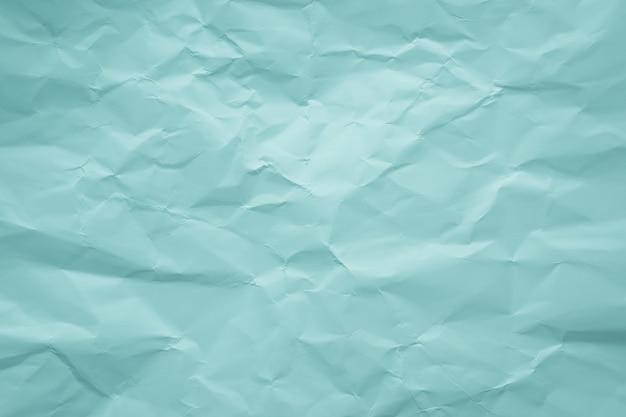 Zmięty zielony papier. pastelowy, delikatny kolor. abstrakcyjny wzór.
