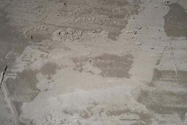Zmrok - szarości betonowa tekstura, ściana z betonowym tynkiem, odświeżania tła pojęcie
