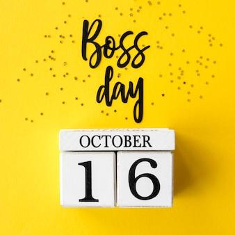 Znak z napisem dzień szefa i kalendarzem