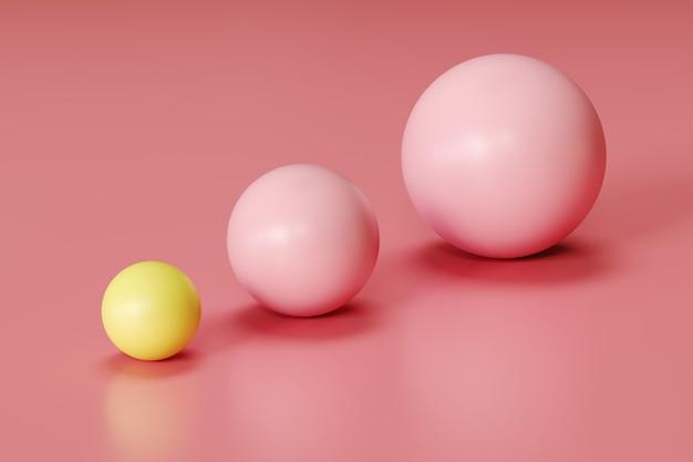 Znakomita żółta kula i różowe kule w różnych rozmiarach na różowym tle. minimalny pomysł koncepcji