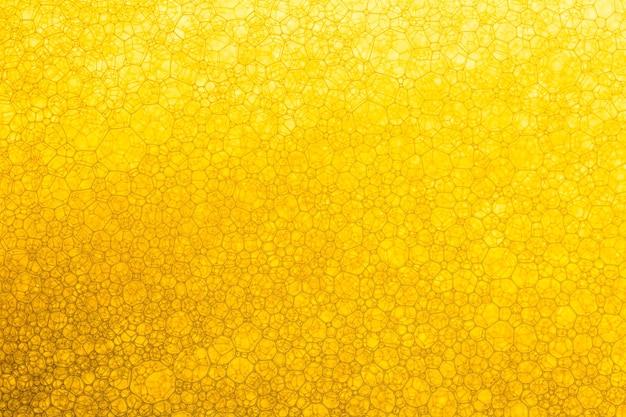 Żółta ciekła powierzchnia russia olej do smażenia miód teksturowana pełna rama