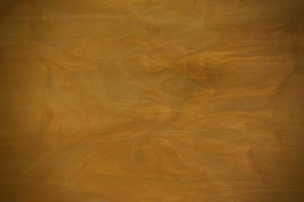 Żółta ciemna szklana tekstura z winietowaniem. miękkie rozmycie ostrości.