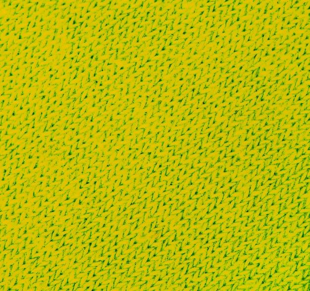 Żółta dzianina tekstura streszczenie tło.