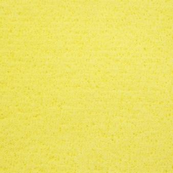 Żółta gąbka gumy tekstury na tle