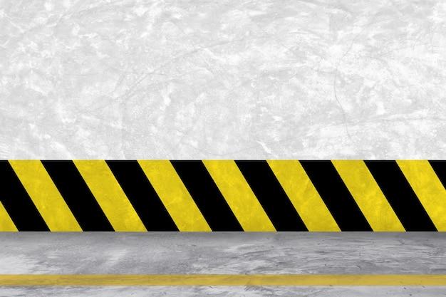 Żółta i czarna linia cementu tle ściany i podłogi.