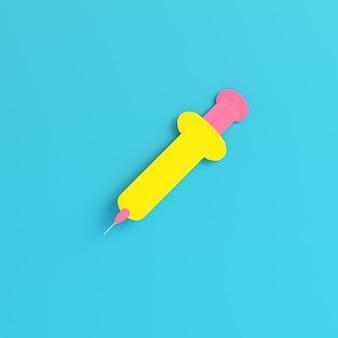 Żółta strzykawka na jasnym niebieskim tle w pastelowych kolorach. koncepcja minimalizmu. renderowania 3d